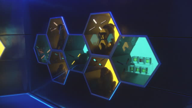 pan right to left of room with chimpanzees, monkeys, or orangutans. see animals in individual windows shaped in octagon form with yellow or blue lights. - octagon stock videos and b-roll footage