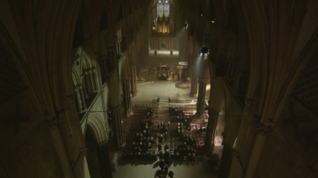 high angle down of funeral at westminster abbey. funeral procession of upper class men and women enter the church. - stereotypically upper class stock videos & royalty-free footage