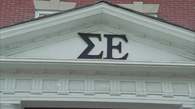 """close angle shot of sigma epsilon sign on the front of brick fraternity house.<p><a href=""""https://www.sonypicturesstockfootage.com/footage?kid=4307"""">for day-night matching shots, click here.</a><p> - youth organisation stock videos & royalty-free footage"""