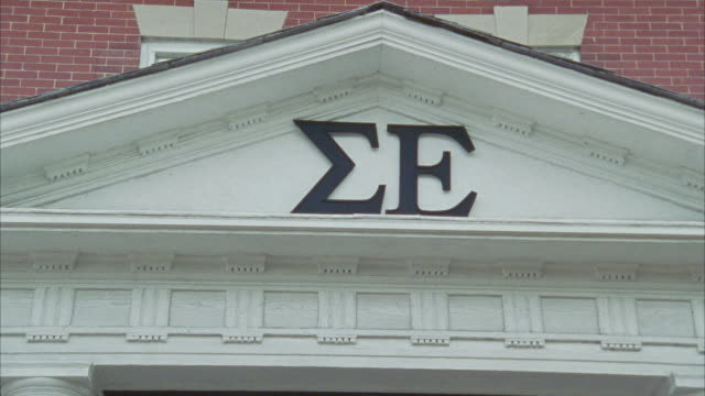 close angle of a sigma epsilon sign on the front of brick fraternity house. - brick house stock videos and b-roll footage