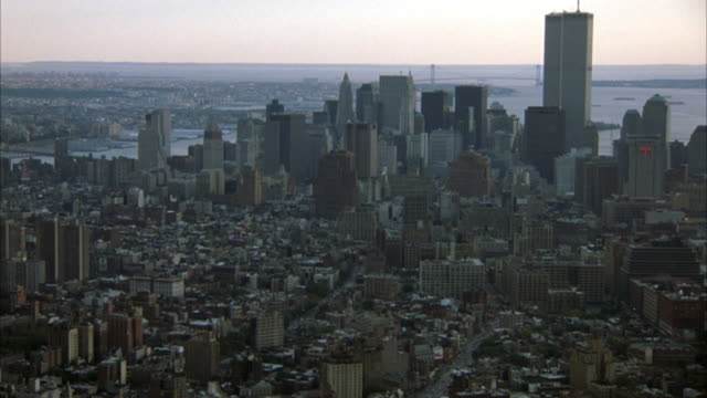 aerial of lower manhattan with pov from north in midtown manhattan. see world trade center twin towers among skyscrapers and hudson river on right. new york skylines. - world trade center manhattan stock videos & royalty-free footage