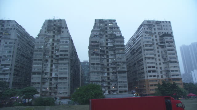 WIDE ANGLE OF HIGH RISE OR MULTI-STORY IDENTICAL APARTMENT BUILDINGS. COULD BE TOWER OR COUNCIL BLOCK HOUSING PROJECTS.
