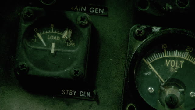 CLOSE ANGLE OF MILITARY HELICOPTER CONTROL PANELS, CONSOLE, CONTROLS, ALTIMETER, GYROSCOPE.