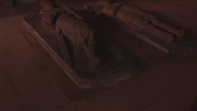 medium angle of marble tombstones on church floor. tombstones are shaped as knights. camera zooms in over tombstone from feet to head of statue. graveyards. gravestones. headstones. knights templar. - knights templar stock videos & royalty-free footage