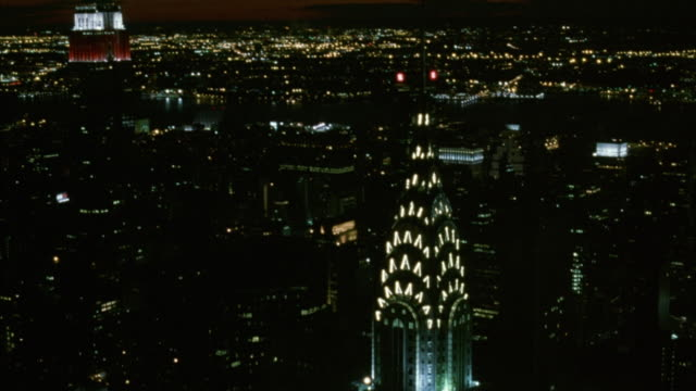 aerial circling the chrysler building in midtown manhattan. empire state building and beautiful dusk sky in background. - world trade center manhattan video stock e b–roll