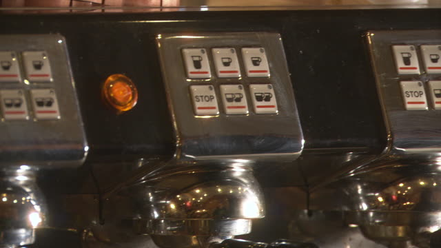CLOSE ANGLE OF ESPRESSO MACHINE IN COFFEE HOUSE. COULD BE COFFEE SHOP, CAFE, OR RESTAURANT IN SEATTLE. SEE METAL LEVERS AND BUTTONS.