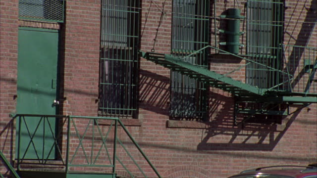 hand held angle of a brick building, probably an apartment building or converted loft.  could be manhattan, new york, queens, or the bronx. - bronx new york stock videos and b-roll footage