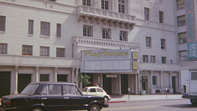 """zoom in on sign that says """"playhouse"""" outside a theater looking building. see small sign hanging under that says """"rene's school of classical ballet"""" - 1975 stock videos and b-roll footage"""