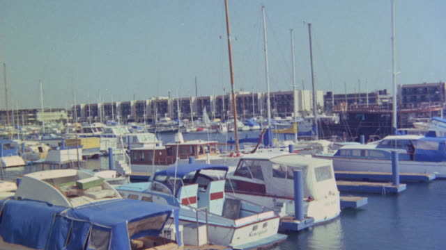 WIDE ANGLE OF BOATS OR SAILBOATS DOCKED IN MARINA DEL REY, LOS ANGELES. HARBORS. PORTS.