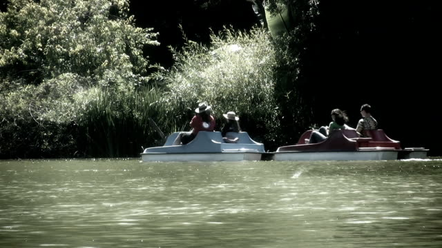 paddle boat  (hd) - pedal boat stock videos and b-roll footage