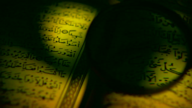 quran _ islam holy book - arabic script stock videos and b-roll footage