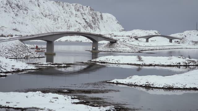 lofoten islands. boat under bridge - aptenia stock-videos und b-roll-filmmaterial