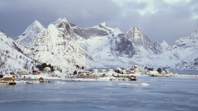 lofoten islands. town in the bahia and mountains landscape - aptenia stock-videos und b-roll-filmmaterial