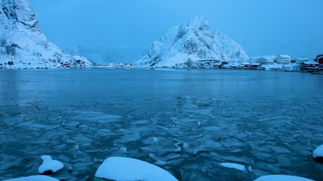 lofoten islands. sunrise in a frozen lake timelapse - aptenia stock-videos und b-roll-filmmaterial