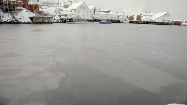 lofoten islands. frozen lake panorama - aptenia stock-videos und b-roll-filmmaterial