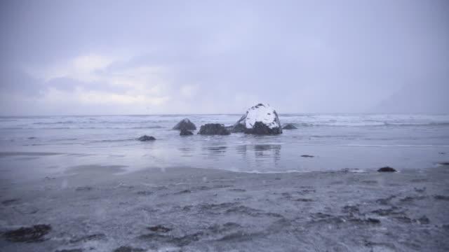 lofoten islands. snowy rock in the beach panorama - aptenia stock-videos und b-roll-filmmaterial