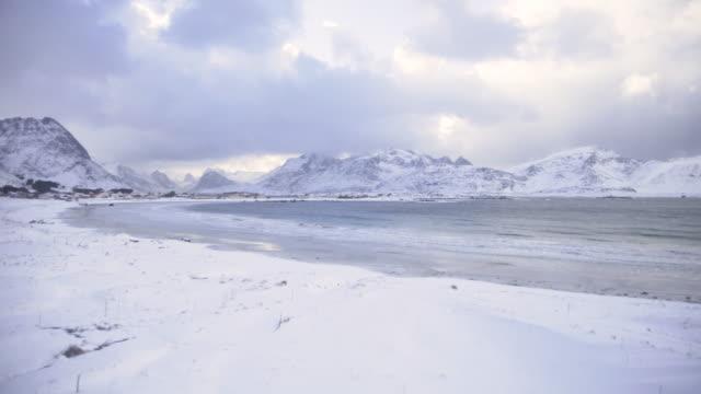lofoten islands. snowy beach general panorama - aptenia stock-videos und b-roll-filmmaterial