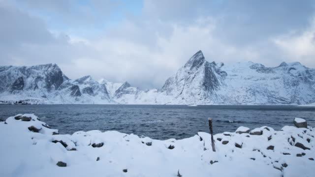 lofoten islands. snow, lake and mountain timelapse - aptenia stock-videos und b-roll-filmmaterial