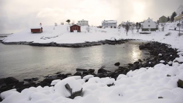 lofoten islands. snowy town in the shore - aptenia stock-videos und b-roll-filmmaterial