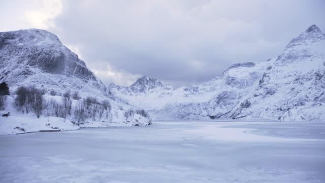 lofoten islands. frozen lake and mountains - aptenia stock-videos und b-roll-filmmaterial