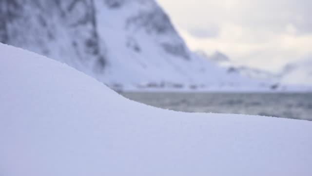 lofoten islands. snow and town in the shore trasfoco - aptenia stock-videos und b-roll-filmmaterial
