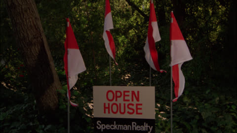 """pan right to left from """"open house"""" sign to upper class two story mansion with pillars or columns. yellow mercedes benz convertible and station wagon cars in fg. roundabout driveway. - mercedes benz markenname stock-videos und b-roll-filmmaterial"""
