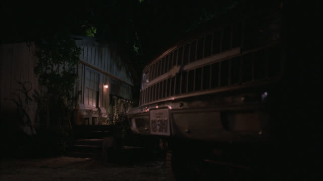 medium angle of cabin or farmhouse with chevy truck parked in driveway. radiator grille on the truck with texas license plates. - anno 1987 video stock e b–roll