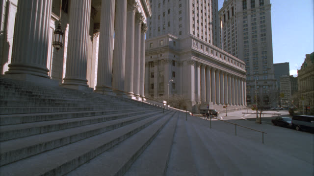 medium angle of steps to new york city supreme court building with columns. manhattan municipal building in bg. government buildings, courthouse or justice building. - courthouse stock videos & royalty-free footage