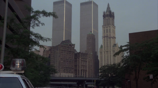 zoom in on world trade center twin towers. skyscrapers or high rise office buildings. manhattan. - world trade center manhattan video stock e b–roll