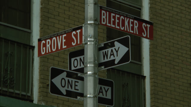 close angle of grove and bleecker street. one way street sign. greenwich village. - one way stock videos and b-roll footage