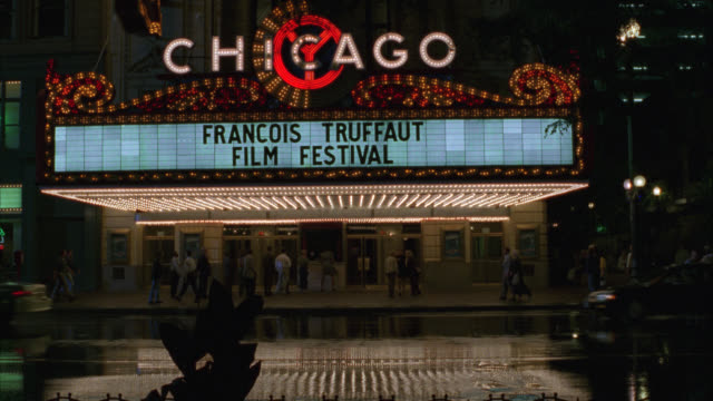 "vídeos y material grabado en eventos de stock de wide angle of ""chicago"" movie theatre house with neon sign and marquee. lights. sign reads ""francois truffaut film festival."" ticket booth. - 1996"