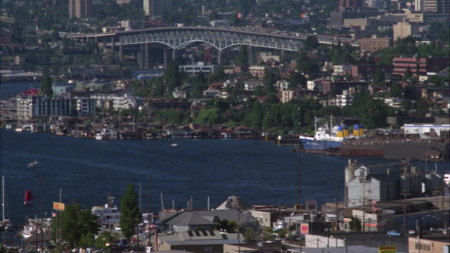 pan right to left from seattle skyline or cityscape to see harbor. sailboats, boats, and ships. - 1986 stock-videos und b-roll-filmmaterial