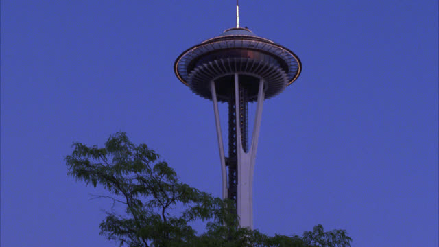 up angle of space needle, restaurant and observation deck. landmarks. trees in fg. - 1986 stock videos & royalty-free footage