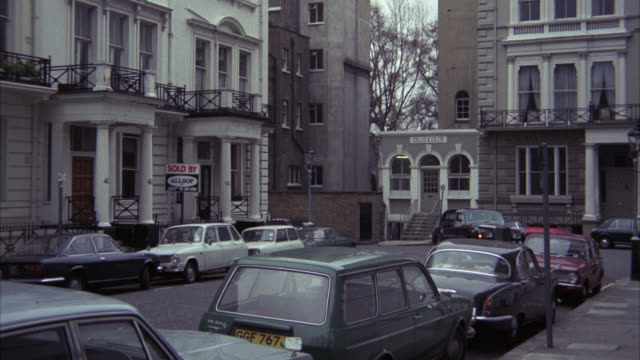pan right to left following rolls royce car driving through upper class residential area. ennismore gardens area. multi-story apartment buildings or flats. matching r818-5 r818-6 - rolls royce stock videos and b-roll footage