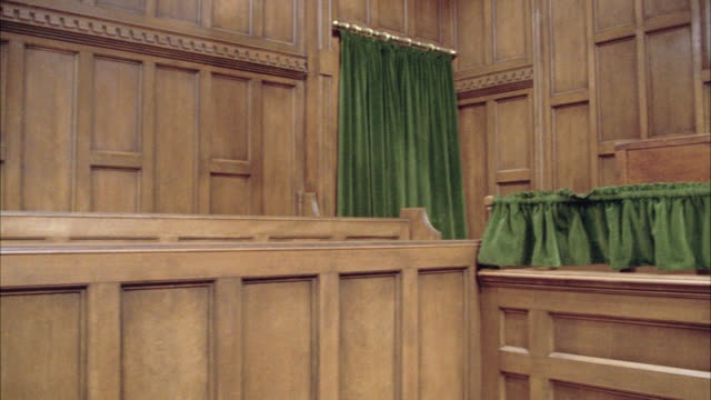 pan left to right of empty british courtroom. government building. benches. - court room stock videos & royalty-free footage