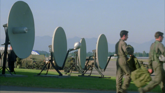 "wide angle of four radar or satellite dishes at air force base. sign reads ""flight operations tactical fighter squadron."" military vehicles driving around. soldiers in camouflage and fatigues. military convoy drives by from right to left. building with fl - us air force stock videos & royalty-free footage"