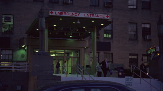 "medium angle of old brick hospital, emergency room entrance, staircase to parking lot, cars parked. bus stopped. men, women enter, exit building. matching dx/nx 2253-032 to 2253-046.<p><a href=""https://www.sonypicturesstockfootage.com/footage?kid=4379"">fo - www stock videos & royalty-free footage"