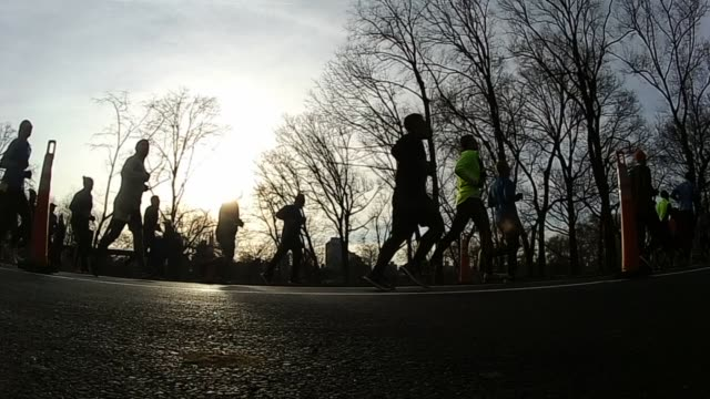 running race in central park sunrise slow motion - salmini stock videos and b-roll footage