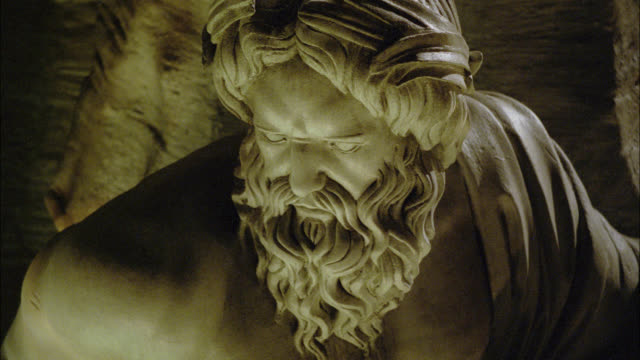 high angle down of sculpture or statue. light reflects onto sculpture. could be from water. could be fountain. could be fountain of the four rivers in piazza navona rome. - piazza navona stock videos & royalty-free footage