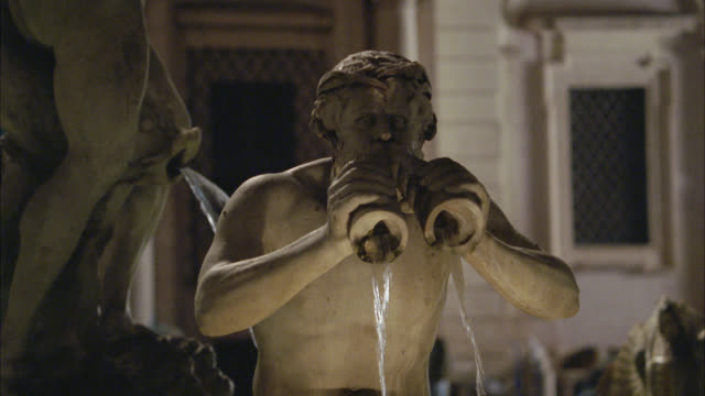 close angle of sculpture on fountain. water. could be fountain of the four rivers at piazza navona. - piazza navona stock videos & royalty-free footage