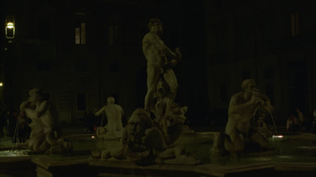 medium angle of fountain or fontana del moro rome in piazza navona. rome. - piazza navona stock videos & royalty-free footage