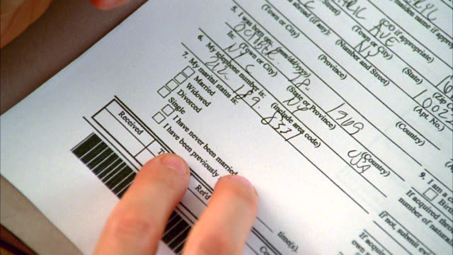 close angle of woman's hands writing, filling out form or paperwork. - form filling stock videos & royalty-free footage