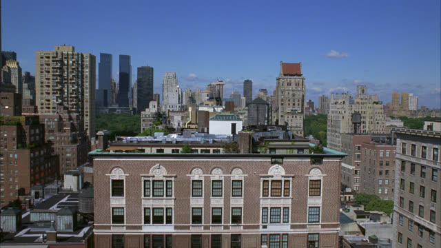wide angle of manhattan city skyline, pov from high rise office, apartment or condominium building on the upper west side. time warner center towers or skyscrapers visible in bg. brick buildings. - entertainment center stock videos and b-roll footage