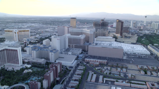 aerial of the las vegas strip. camera moves captures the north part of the strip then circles around to  the south. visible landmarks include: the  mirage, wynn, stratosphere, paris, bally's, and  bellagio hotels. - bally's las vegas stock videos & royalty-free footage