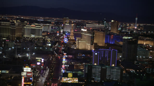 aerial of the las vegas strip at night. camera begins at the south end of the strip and moves north. visible landmarks include: mgm grand, paris, bellagio, new york- new york, bally's, flamingo, and caesar's palace hotels. casinos. - bally's las vegas stock videos & royalty-free footage