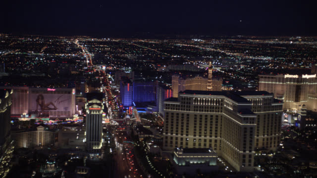 aerial of the las vegas strip. camera captures the north side of the strip. visible landmarks include: planet hollywood, the  paris, bellagio, bally's, flamingo, and caesar's palace hotels. casinos. - bally's las vegas stock videos & royalty-free footage