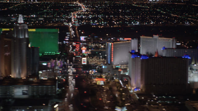 AERIAL OF VEGAS STRIP. CAMERA MOVES FROM SOUTH TO NORTH AS STRIP PASSES BY. HOTELS AND CASINOS INCLUDE WYNN, VENETIAN, TREASURE ISLAND, HARRAH'S, IMPERIAL PALACE, FLAMINGO, CAESAR'S PALACE, BELLAGIO, PARIS, PLANET HOLLYWOOD, MGM GRAND, NEW YORK NEW YORK,