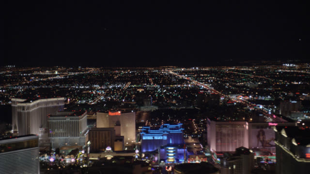 AERIAL OF VEGAS STRIP. CAMERA MOVES FROM NORTH TO SOUTH AS STRIP PASSES BY. HOTELS AND CASINOS INCLUDE WYNN, VENETIAN, TREASURE ISLAND, HARRAH'S, IMPERIAL PALACE, FLAMINGO, CAESAR'S PALACE, BELLAGIO, PARIS, PLANET HOLLYWOOD, MGM GRAND, NEW YORK NEW YORK,