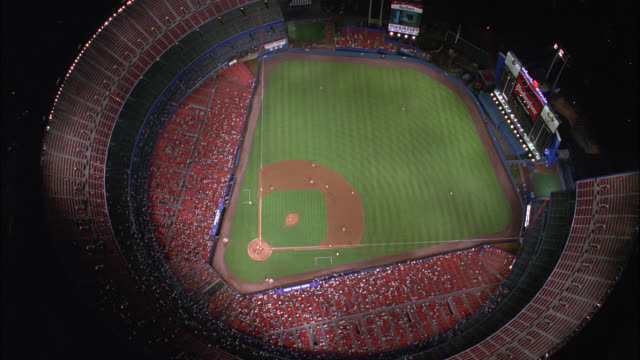 aerial birdseye pov of baseball game at shea stadium with crowd of spectators in stands. baseball field. sports. queens, flushing meadows-corona park. - flushing meadows corona park stock videos and b-roll footage