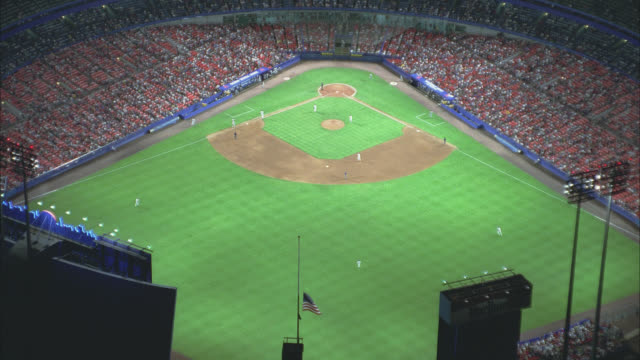 high angle down of baseball game at shea stadium with crowd of spectators in stands. baseball field. sports. queens, flushing meadows-corona park. - flushing meadows corona park stock videos and b-roll footage